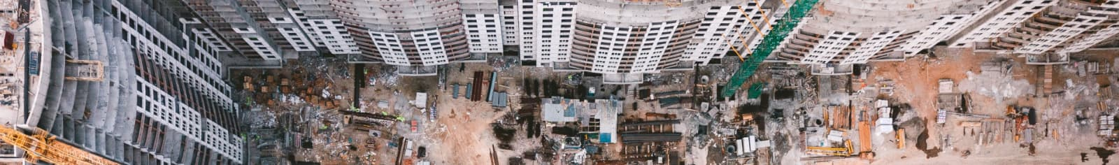 Birds-eye view of an engineering site among highrise buildings
